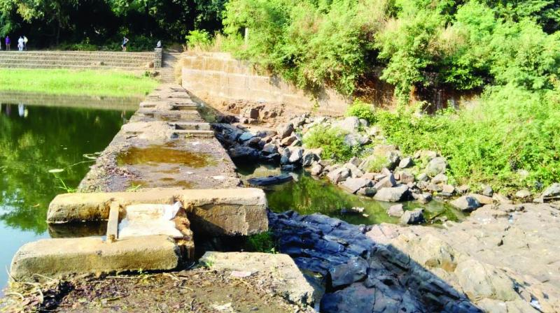 A 7-ft wall to be built along the river as it exits SGNP.