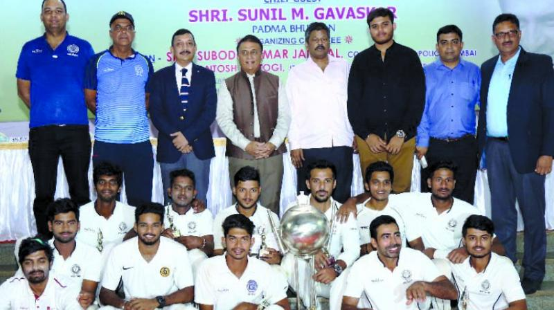 The victorious Parkhophene Cricketers proudly pose with the glittering Police Shield Trophy along with Chief Guest, former India captain Sunil Gavaskar, S.K. Jaiswal, Commissioner of Police, Greater Mumbai, Dr. P.V. Shetty, founder of Parkhophene Cricketers and Deepak Patil, Joint Hon. Secretary, Mumbai Police Gymkhana.