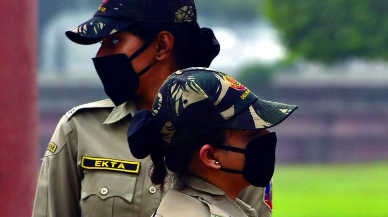 "Police personnel wear masks for protection against air pollution in New Delhi on Tuesday. A thick haze engulfed the city on Tuesday as the air quality remained in the ""severe"" category. (Photo: PTI)"