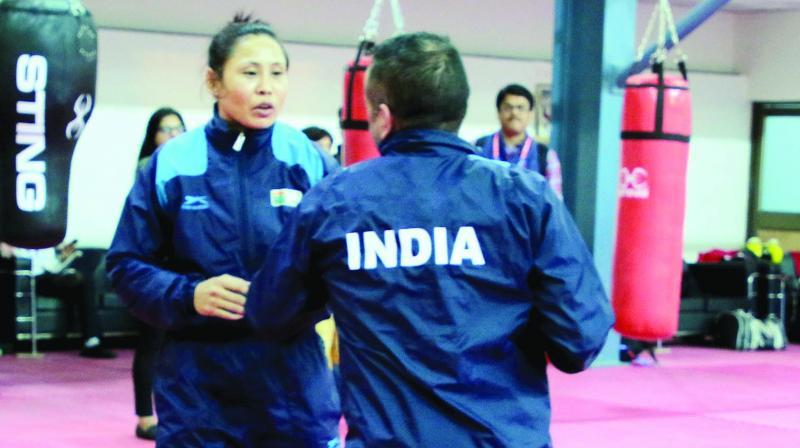 L. Sarita Devi (left) and Manisha Maun (right above) at a training session in New Delhi on Thursday.