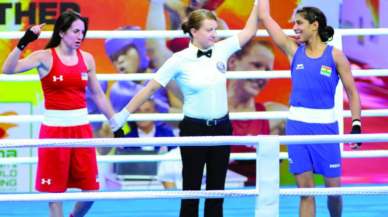 Manisha Moun (blue) is all smiles as the referee declares her winner against Christina Cruz of USA in the 54kg pre-quarterfinals in New Delhi on Friday. (Photo: PTI)
