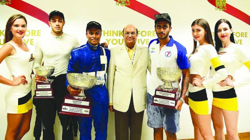 (L-R) Ashwin Datta, Karthik Tharani and Nayan Chatterjee holding trophies.