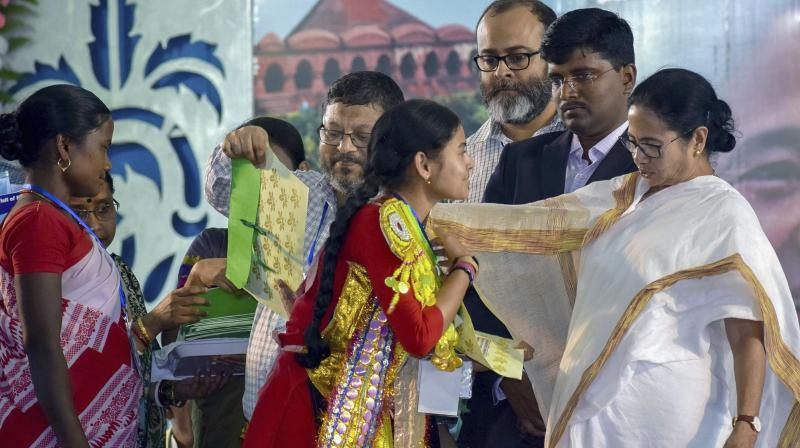 Chief minister Mamata Banerjee during a developmental programme of her government in Bankura district  on Wednesday. (Photo: PTI)