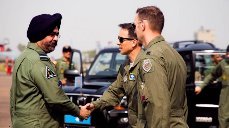 Chief of the Air Staff Air Chief Marshal B.S. Dhanoa meets with the members of  US Air Force contingent at Air Force Station Kalaikunda on Wednesday.