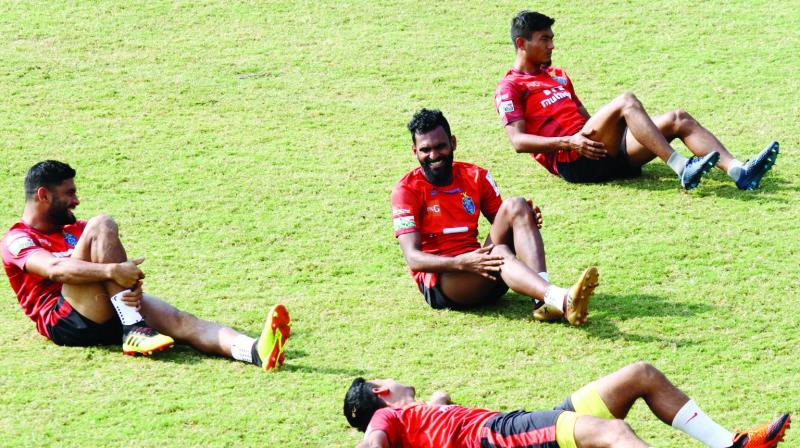 Kerala Blasters' C.K. Vineeth and Anas Edathodika share a laugh during training in Kochi on Thursday. (Photo: Asian Age)
