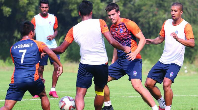 Delhi Dynamos players at a training session in Jamshedpur on Tuesday.