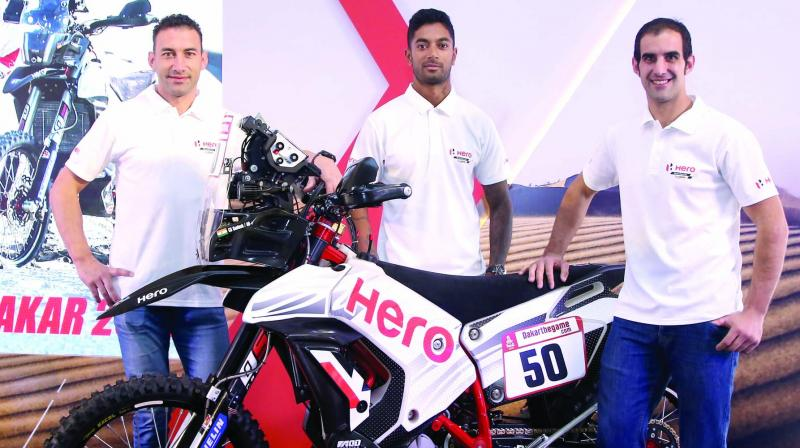 Hero MotoSports Team Rally's ace riders Joaquim Rodrigues (from left), C.S. Santosh and Oriol Mena at the team presentation ahead of the Dakar 2019 in New Delhi.