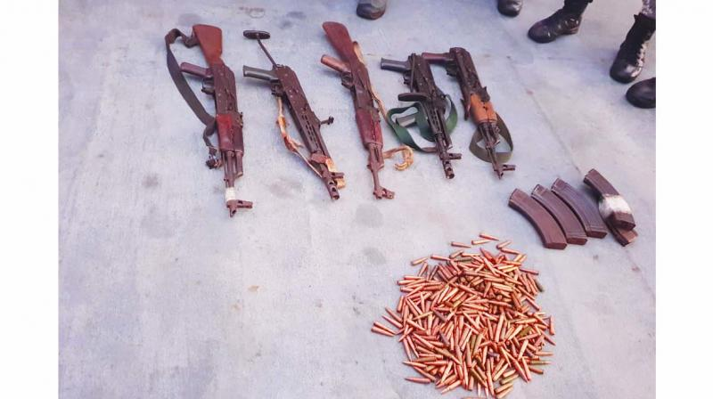 The seized arms and ammunition.