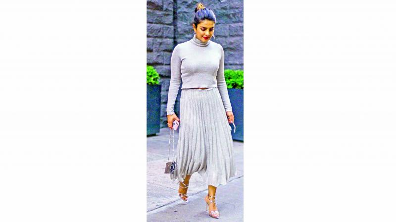 Priyanka Chopra looks like a million bucks in this grey pleated skirt outfit.