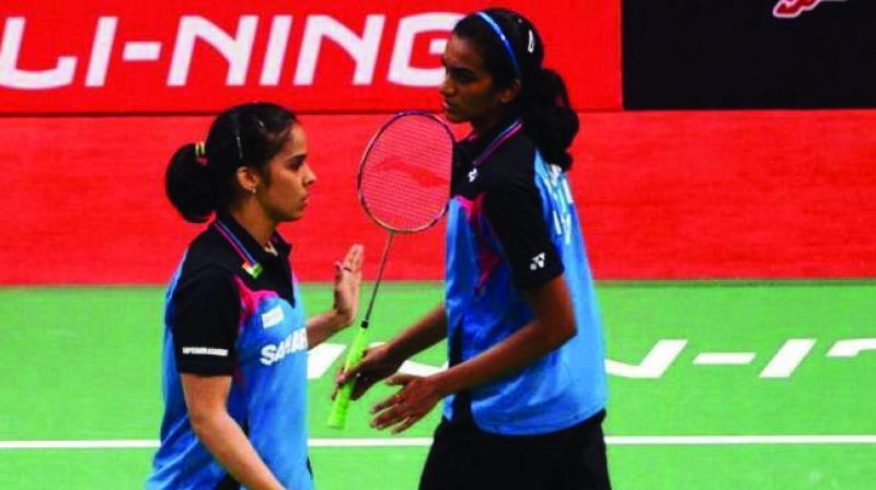 Saina Nehwal (left) and P.V. Sindhu.