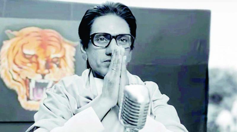 A still from the movie Thackeray