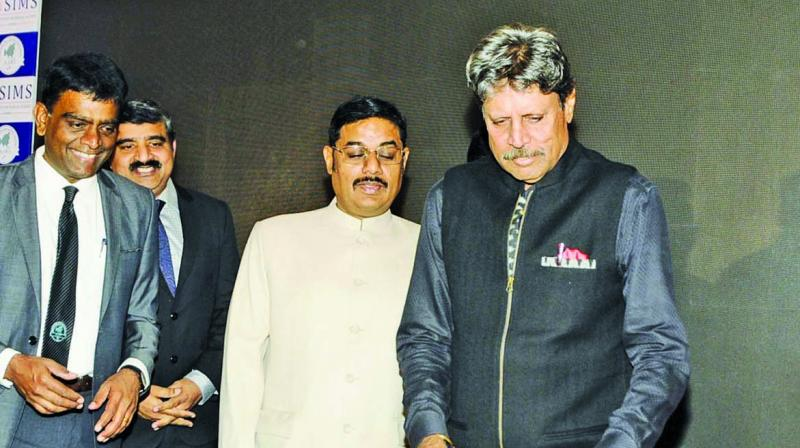 Kapil Dev cuts a cake during a  promotional event  in Chennai on Wednesday.