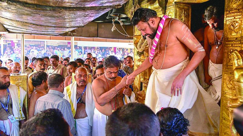 Priests carry out 'purification' of the Lord Ayyappa Temple after two women in their early 40s entered the shrine and offered prayers in Sabarimala, Kerala, on Wednesday. (Photo: PTI)
