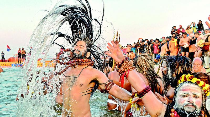 Devotees taking a dip into the holy water during the ongoing Kumbh Mela.