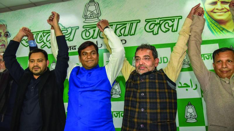 A file photo of RJD leader Tejashwi Yadav with other grand alliance leaders in Patna.