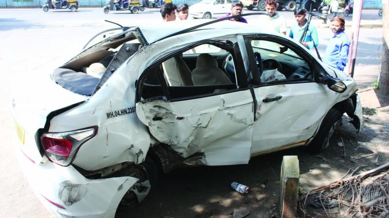 Car turns turtle in Thane