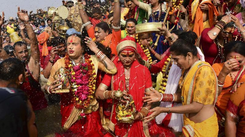 Transgender rights activist Laxmi Narayan Tripathi and other memebers takes a holy dip at Sangam during the Kumbh Mela in Prayagraj on Monday. (Photo: PTI)
