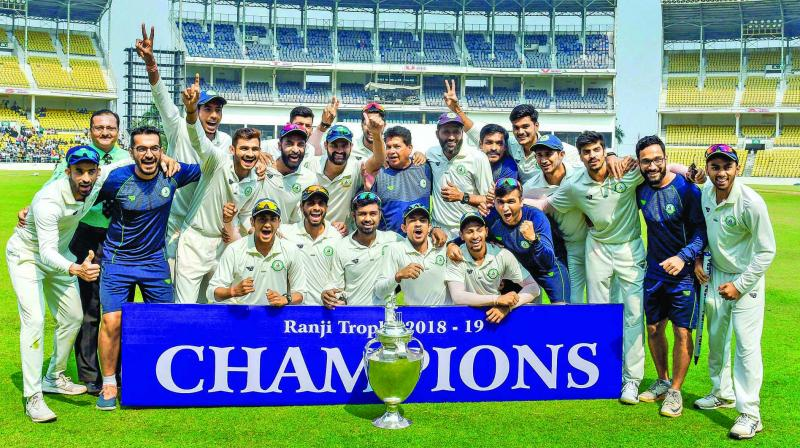 Vidarbha players celebrate their victory over Saurashtra in the Ranji Trophy final at Nagpur on Thursday. (Photo: PTI)