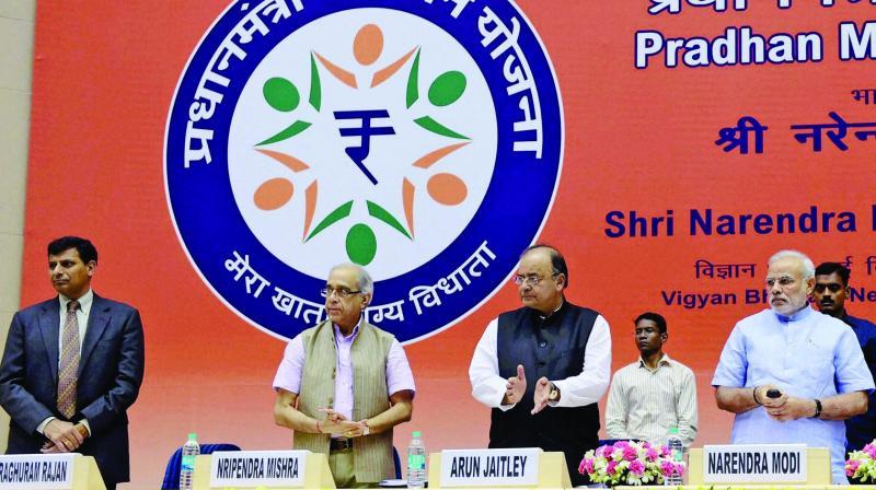 Prime Minister Narendra Modi launches the Pradhan Mantri Jan Dhan Yojana in 2014 in the presence of finance minister Arun Jaitley, principal secretary to the Prime Minister Nripendra Misra and then RBI governor Raghuram Rajan.(Photo: AP)