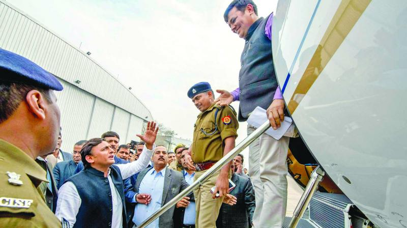 Samajwadi Party president Akhilesh Yadav being prevented by district officials from boarding a flight for Prayagraj at Lucknow airport on Tuesday. (Photo: PTI)