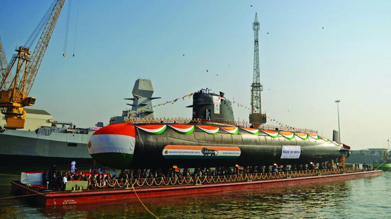 The Indian Navy's third Scorpene-class submarine Karanj is pulled into the Arabian Sea after its launch ceremony at the Mazagon Dock Shipyard in Mumbai. (Photo: AP)