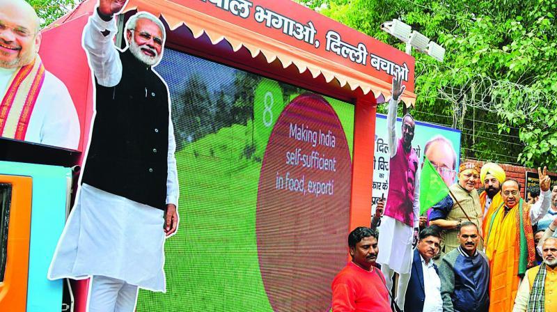 BJP MP Giriraj Singh and Union minister Vijay Goel flag off the video van in New Delhi on Wednesday. (Photo: BUNNY SMITH)