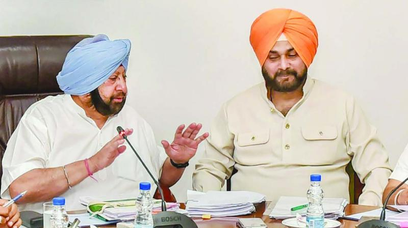 A file photo of chief minister Amarinder Singh with minister Navjot Singh Sidhu.