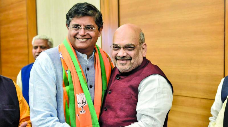 Former Biju Janata Dal MP Baijayant Jay Panda greets BJP president Amit Shah after joining the saffron party in New Delhi on Monday. (Photo: PTI/File)