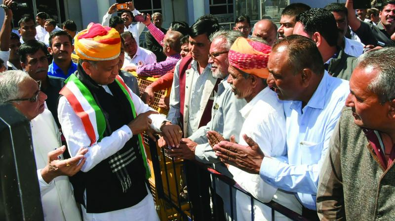 Rajasthan chief minister and senior Congress leader Ashok Gehlot meets party workers during Holi celebrations in Jodhpur on Wednesday. (Photo: PTI)