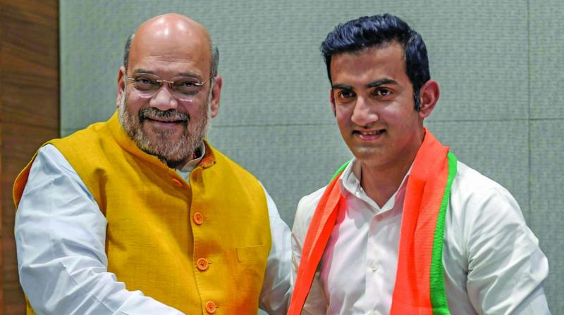 Former cricketer Gautam Gambhir, who joined the Bharatiya Janata Party, being greeted by party chief Amit Shah in New Delhi on Friday. (Photo: PTI)