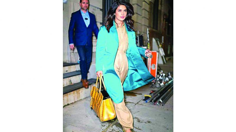 Priyanka Chopra adds a touch of colour with a blue over coat.
