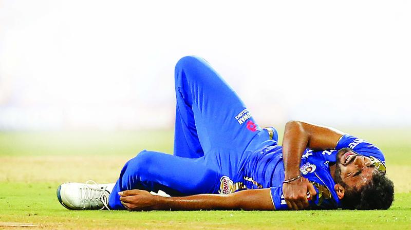 Jasprit Bumrah grimaces in pain. (Photo: PTI)