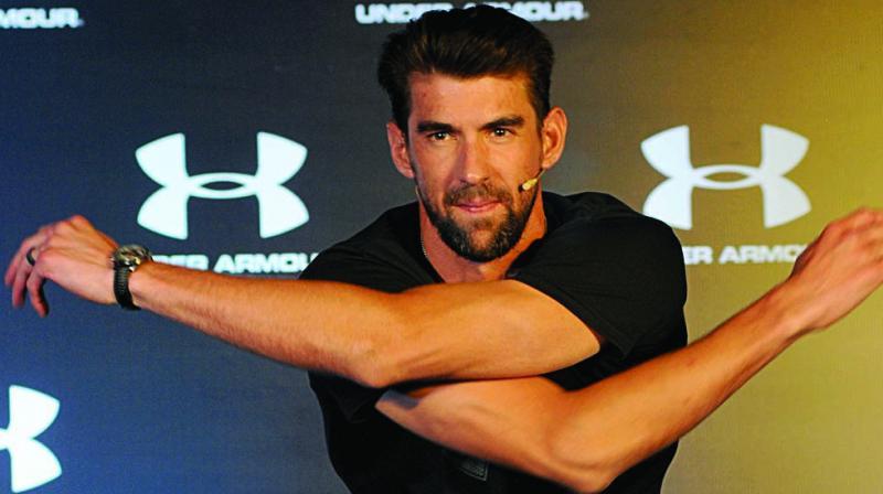 US swimmer Michael Phelps gestures during an interaction in Delhi on Tuesday. (Photo: BIPLAB BANERJEE)