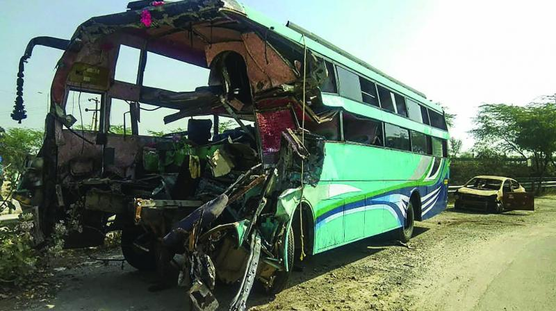 The ill-fated bus which rammed into a truck on Yamuna Expressway on Friday. (Photo: PTI)
