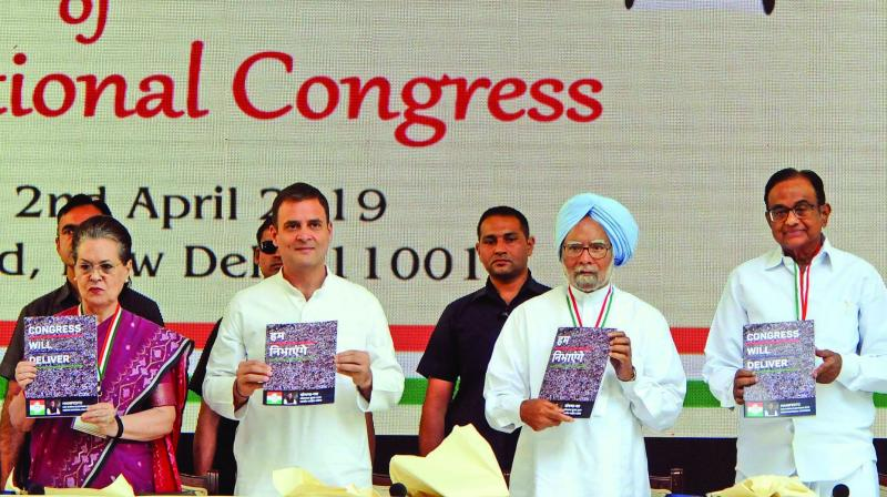UPA chairperson Sonia Gandhi, Congress chief Rahul Gandhi, former PM Manmohan Singh and former Union minister P. Chidambaram release the party's manifesto for the upcoming general elections in New Delhi on Tuesday. (Photo: G.N. JHA)