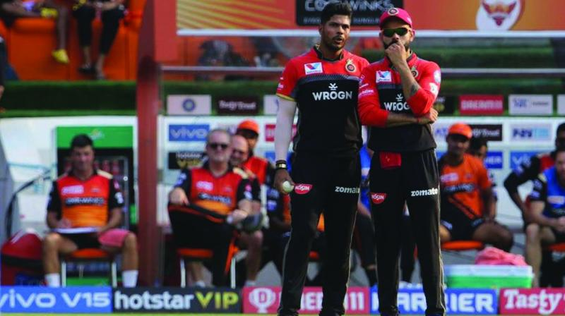 A downcast Royal Challengers Bangalore captain Virat Kohli (right) speaks to fast bowler Umesh Yadav during the away match against Sunrisers Hyderabad in this file photo. (Photo: BCCI)
