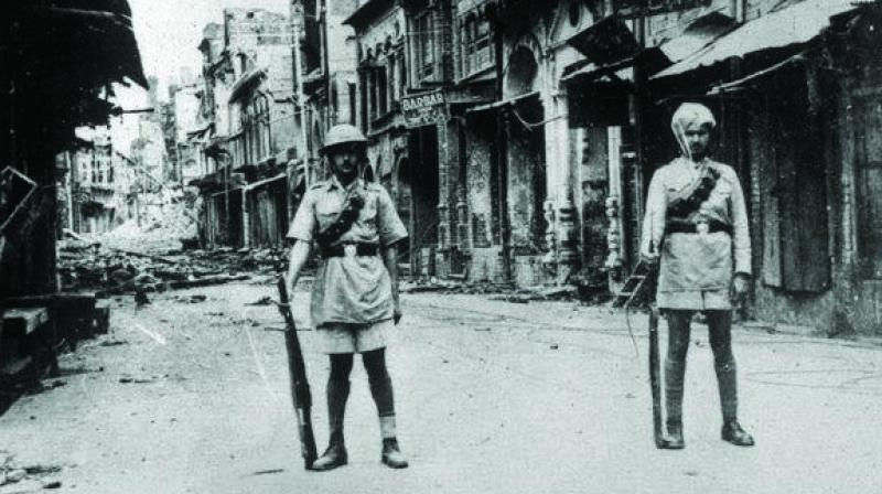 Two cops at Jallianwala Bagh, after the tragedy.