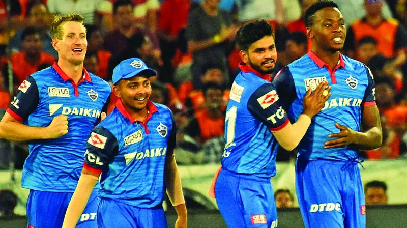 Kagiso Rabada (right) celebrates a Sunrisers wicket with his Delhi teammates during their IPL match in Hyderabad on Sunday. (Photo: P. Surendra)