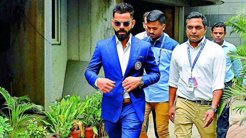 Captain Virat Kohli leaves the BCCI office after attending the selection meeting in Mumbai on  Monday. (Photo: AFP)