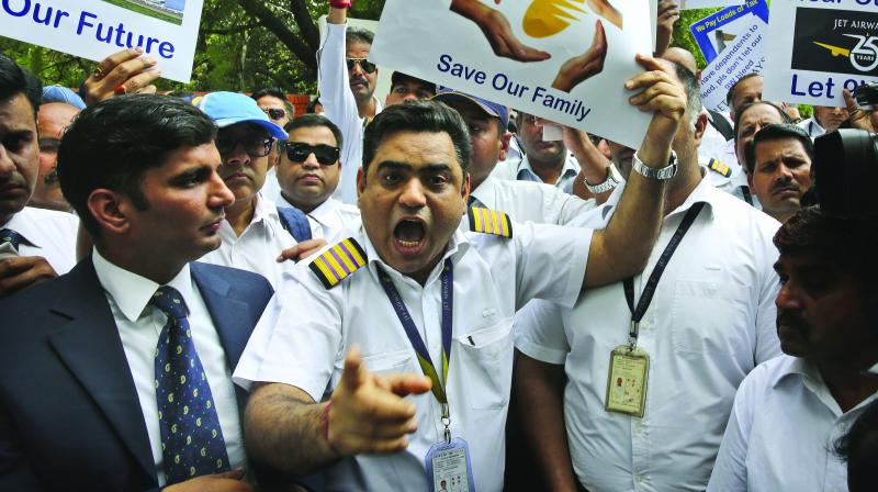 Jet Airways' employees gather to appeal to the government to save their company, in New Delhi on Thursday. (Photo: AP)