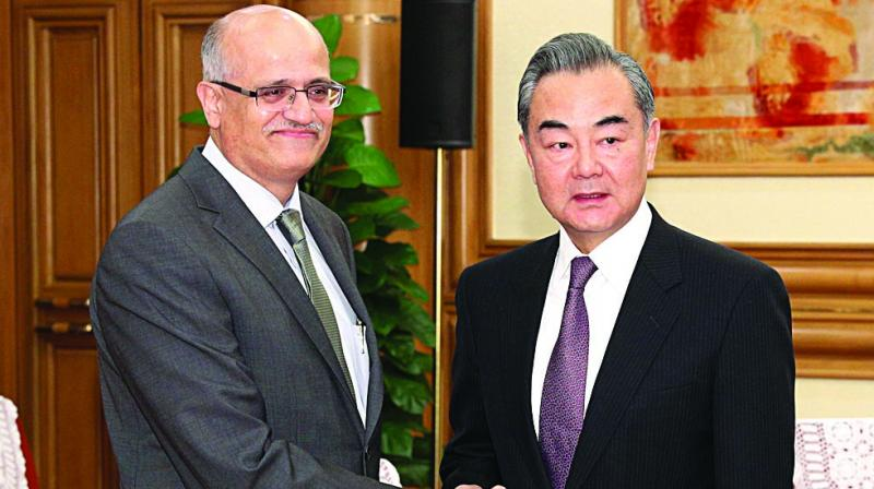 Indian foreign secretary Vijay Keshav Gokhale and Chinese foreign minister Wang Yi pose for a photo during a meeting in Beijing on Monday. (Photo: AP)