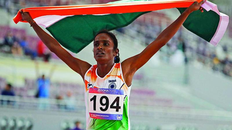 Gomathi Marimuthu celebrates after winning gold in the women's 800 metres final at the Asian Athletics Championships in Doha. (Photo: AP)