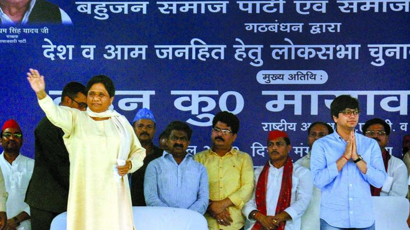 BSP supremo Mayawati waves during an election rally in Lucknow on Tuesday. (Photo: PTI)