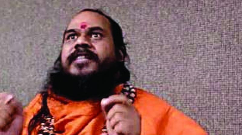 Mahamandaleswar Swami Vairagyanand at a press conference on Monday.