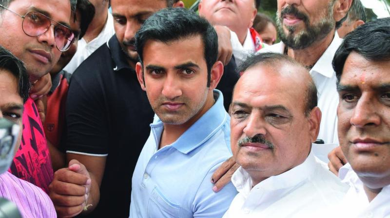 party MP from East Delhi Gautam Gambhir with supporters on Friday. (Photo: ASIAN AGE)