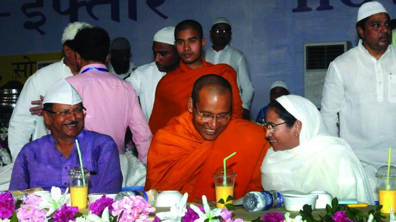 Chief minister Mamata Banerjee talking with a Buddist monk during the ifter party organised by Kolkata Municipal Corporation at Park Circus Maidan on Monday. (Photo: Abhijit Mukherjee)