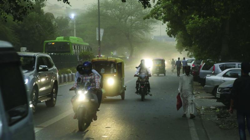 Commuters during a duststorm in New Delhi on Wednesday.  (Photo: AP)