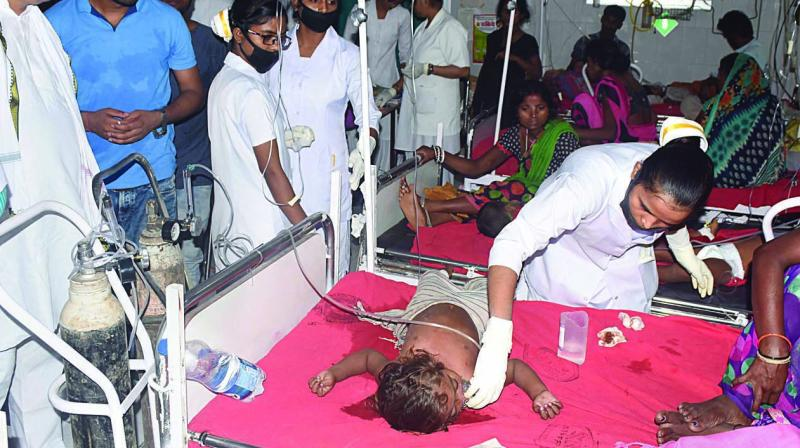 Children showing symptoms of  Acute Encephalitis Syndrome (AES) being treated at a hospital in Muzaffarpur, Bihar, on Saturday. (Photo: PTI)