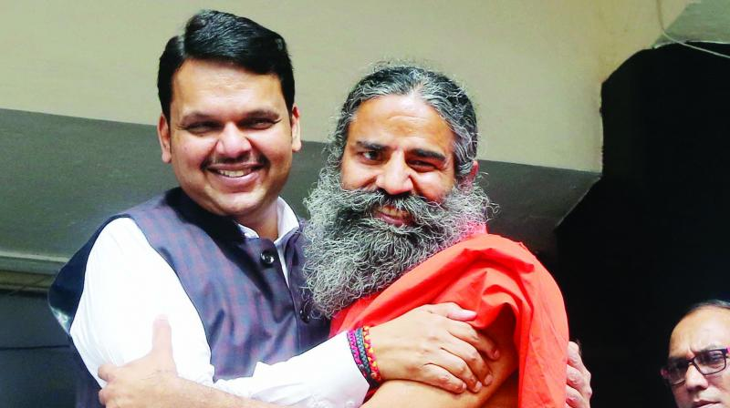 Fadnavis greets Ramdev at Mantralaya. (Photo: RAJESH JADHAV)