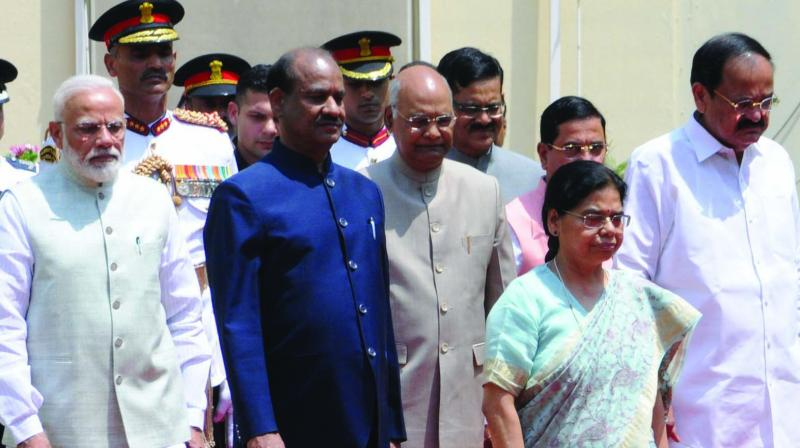 President Ram Nath Kovind, accompanied by vice-president M, Venkaiah Naidu,  PM Narendra Modi, Speaker Om Birla and other dignitaries, proceeds to the Central Hall of Parliament to address its joint session in New Delhi on Thursday. Also seen is Lok Sabha secretary-general Snehlata Shrivastava. (Photo: G.N. Jha)
